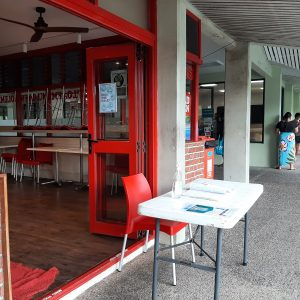 USP students queue to enter an on-campus store